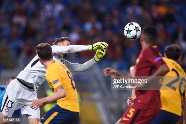 Atletico Madrid's Slovenian goalkeeper Jan Oblak deflects a shot during the UEFA Champions League Group C football match between AS Roma and Atletico...