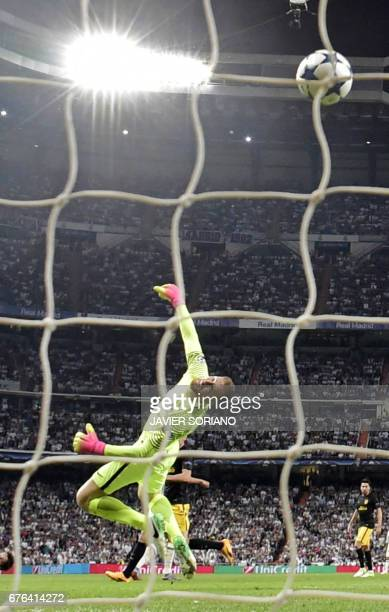 Atletico Madrid's Slovenian goalkeeper Jan Oblak dives to unsuccessfully stop Real Madrid's second goal during the UEFA Champions League semifinal...