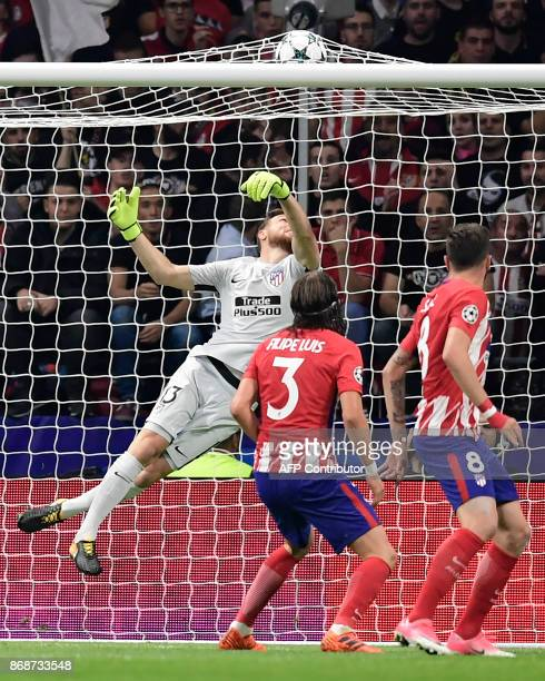Atletico Madrid's Slovenian goalkeeper Jan Oblak looks at the ball touching the net after a goal by Qarabag's Spanish midfielder Michel during the...