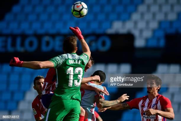 Atletico Madrid's Slovenian goalkeeper Jan Oblak saves a ball during the Spanish league football match RC Celta de Vigo vs Club Atletico de Madrid at...