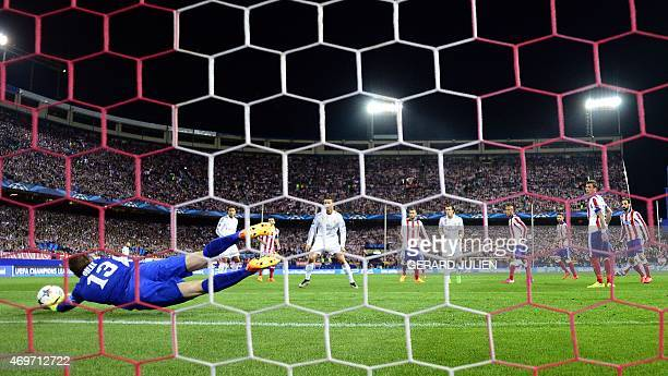 Atletico Madrid's Slovenian goalkeeper Jan Oblak stops a ball during the UEFA Champions League quarter final first leg football match Atletico de...