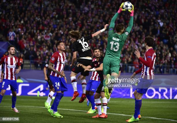 TOPSHOT Atletico Madrid's Slovenian goalkeeper Jan Oblak stops a ball during the UEFA Champions League round of 16 second leg football match Club...