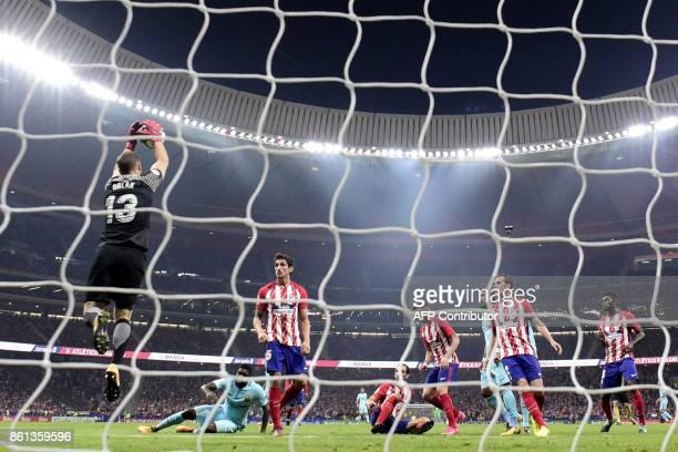 Atletico Madrid's Slovenian goalkeeper Jan Oblak stops the ball during the Spanish league football match Club Atletico de Madrid vs FC Barcelona at...