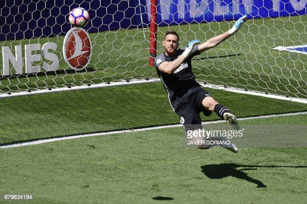 Atletico Madrid's Slovenian goalkeeper Jan Oblak tries to stop a ball during the Spanish league football match Club Atletico de Madrid vs SD Eibar at...