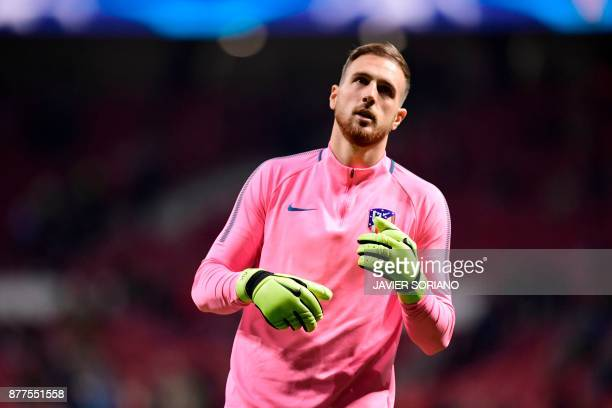Atletico Madrid's Slovenian goalkeeper Jan Oblak warms up ahead of the UEFA Champions League group C football match between Atletico Madrid and AS...