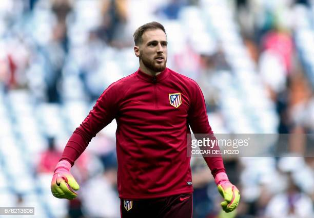 Atletico Madrid's Slovenian goalkeeper Jan Oblak warms up before the UEFA Champions League semifinal first leg football match Real Madrid CF vs Club...