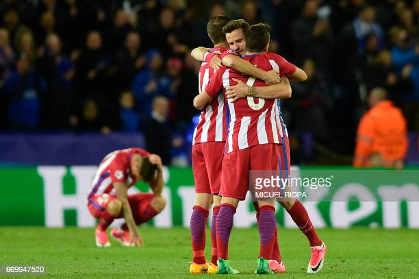 Atletico Madrid's Spanish midfielder Gabi and Atletico Madrid's Spanish midfielder Koke embrace a teammate following the UEFA Champions League...
