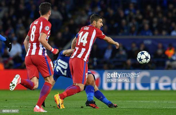 Atletico Madrid's Spanish midfielder Gabi fouls Leicester City's Japanese striker Shinji Okazaki during the UEFA Champions League quarterfinal second...