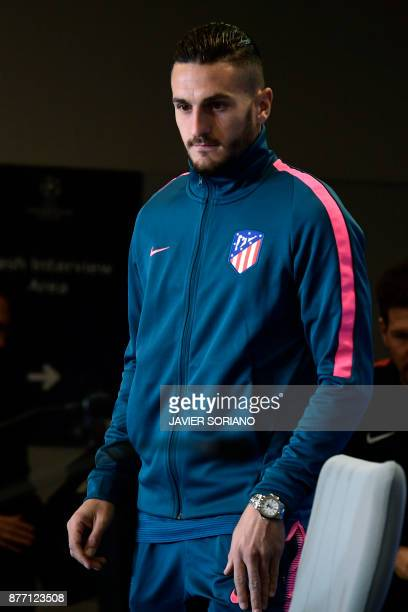 Atletico Madrid's Spanish midfielder Koke arrives to give a press conference at the Wanda Metropolitan stadium in Madrid on November 21 2017 on the...