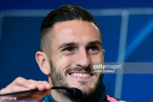Atletico Madrid's Spanish midfielder Koke gives a press conference at the Wanda Metropolitan stadium in Madrid on November 21 2017 on the eve of the...