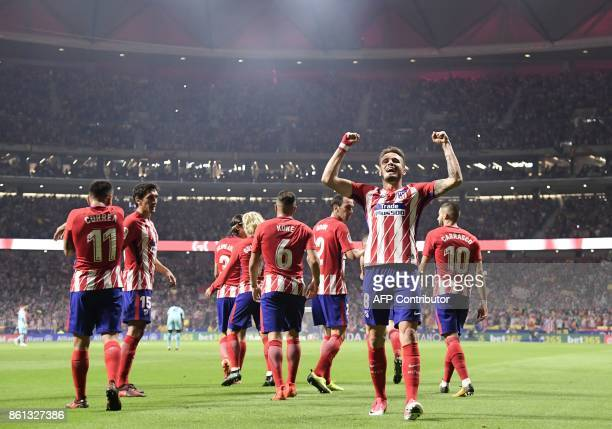 Atletico Madrid's Spanish midfielder Saul Niguez celebrates a goal during the Spanish league football match Club Atletico de Madrid vs FC Barcelona...