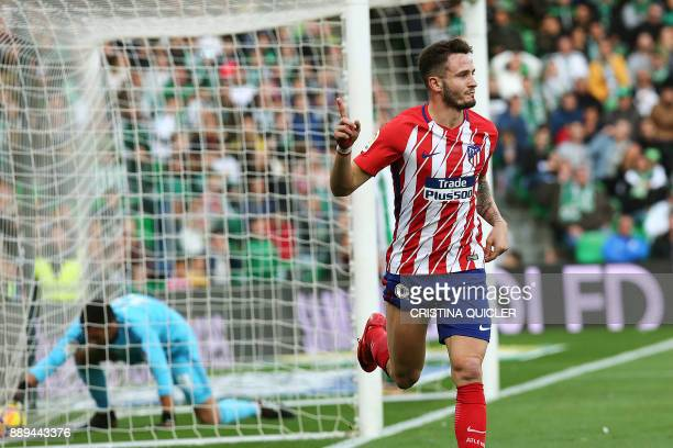 Atletico Madrid's Spanish midfielder Saul Niguez celebrates after scoring a goal during the Spanish league football match between Real Betis and...