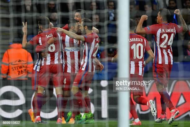 Atletico Madrid's Spanish midfielder Saul Niguez celebrates scoring his team's first goal during the UEFA Champions League quarterfinal second leg...