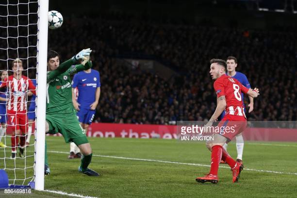 Atletico Madrid's Spanish midfielder Saul Niguez heads the ball to score past Chelsea's Belgian goalkeeper Thibaut Courtois during a UEFA Champions...