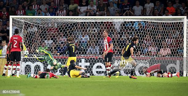 Atletico Madrid's Spanish midfielder Saul Niguez scores a goal during the UEFA Champions League football match between PSV Eindhoven and Atletico...