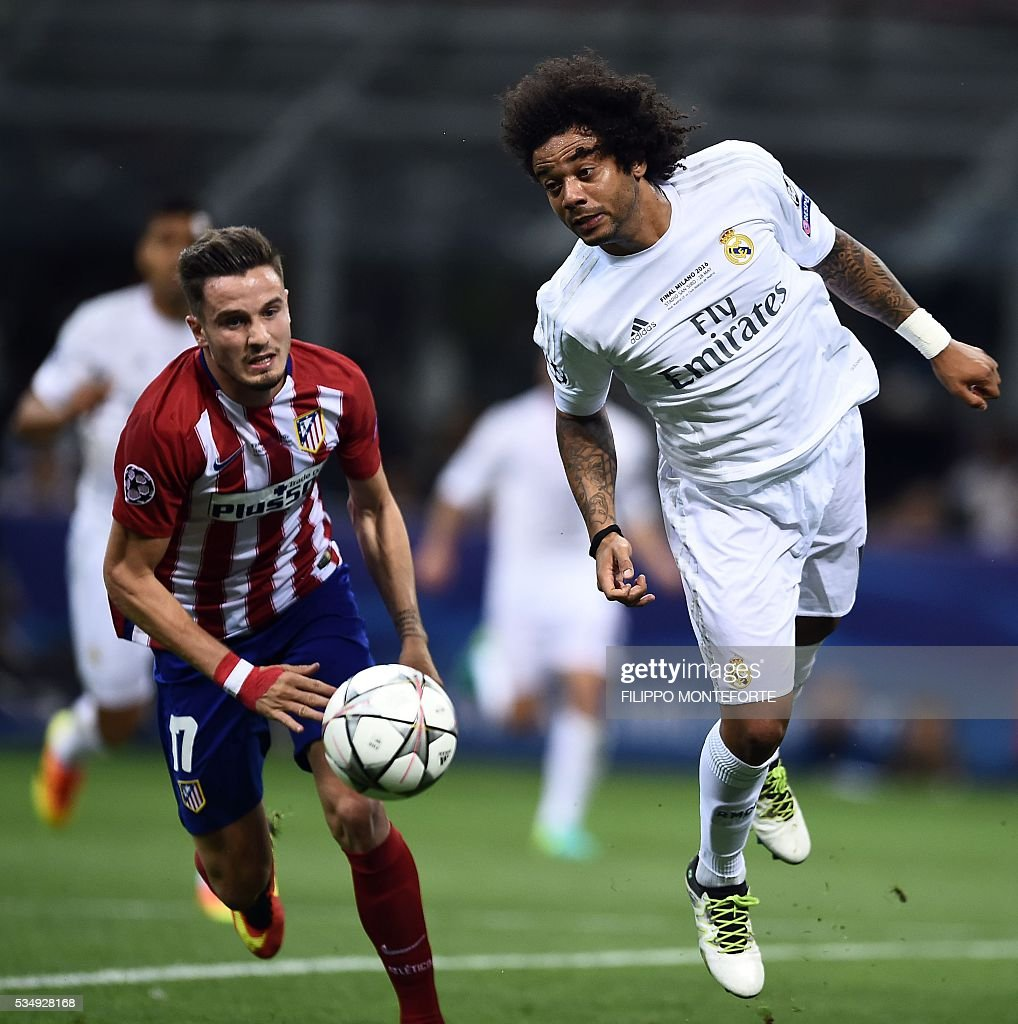 Atletico Madrid's Spanish midfielder Saul Niguez (L) vies with Real Madrid's Brazilian defender Marcelo during the UEFA Champions League final football match between Real Madrid and Atletico Madrid at San Siro Stadium in Milan, on May 28, 2016. / AFP / FILIPPO
