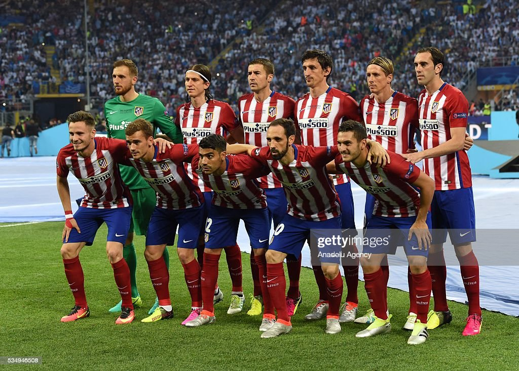 Atletico Madrid's squad (rear left to right) Jan Oblak, Filipe Luis, Gabi, Stefan Savic, Fernando Torres, Diego Godin, (front left to right) Saul Niguez, Antoine Griezmann, Augusto Fernandez, Juanfran and Koke pose for a team photo prior to the UEFA Champions League Final between Real Madrid CF and Atletico Madrid at the Giuseppe Meazza Stadium in Milan, Italy on May 28, 2016 in Milan, Italy.