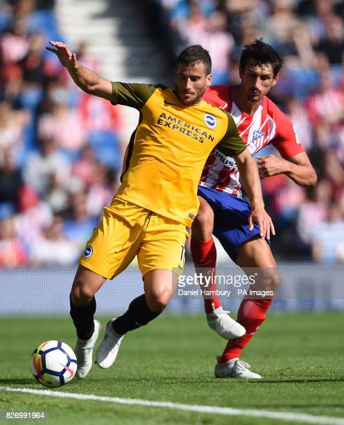 Atletico Madridâs Stefan Savic and Brighton and Hove Albion's Tomer Hemed battle during the preseason friendly at the AMEX Stadium Brighton