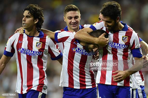 Atletico Madrid's Turkish midfielder Arda Turan celebrates with Atletico Madrid's midfielder Raul Garcia Atletico Madrid's Brazilian defender...