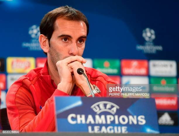 Atletico Madrid's Uruguayan defender Diego Godin gives a press conference at the Vicente Calderon stadium in Madrid on March 14 2017 on the eve of...