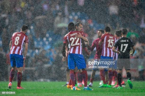 Atletico Madrid's Uruguayan defender Diego Godin is comforted by Atletico Madrid's Ghanaian midfielder Thomas Partey at the end of the UEFA Champions...