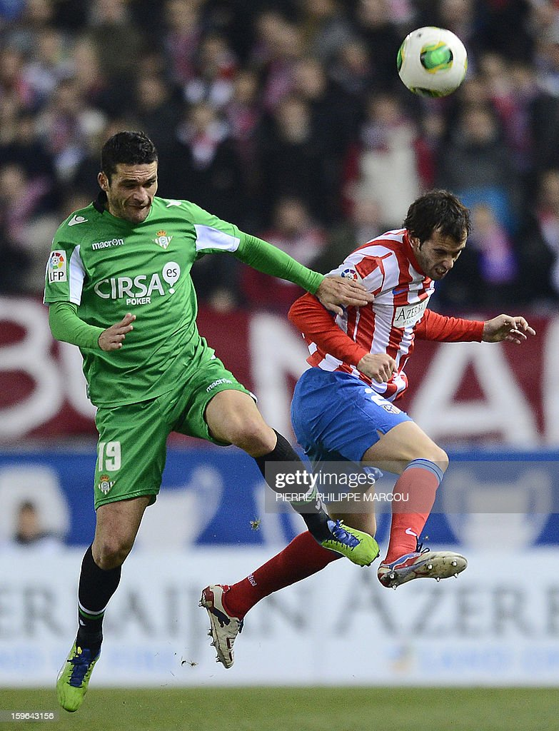 Atletico Madrid's Uruguayan defender Diego Godin (R) vies with Betis' forward Jorge Molina during the Spanish Copa del Rey (King's Cup) quarter-final first leg football match Club Atletico de Madrid vs Real Betis at the Vicente Calderon stadium in Madrid on January 17, 2013.