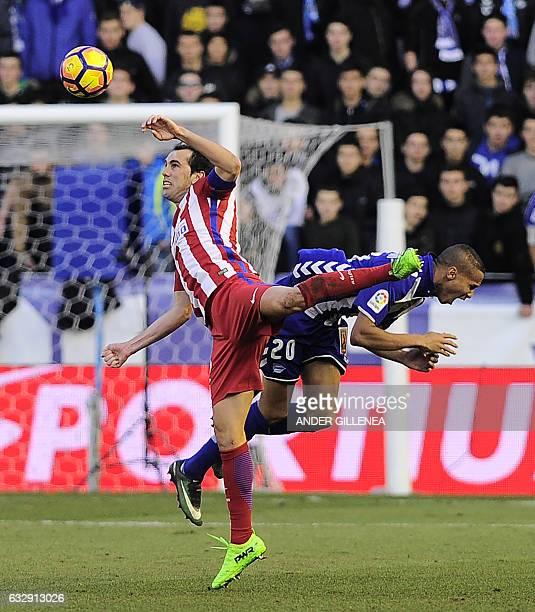 Atletico Madrid's Uruguayan defender Diego Godin vies with Deportivo Alaves' Brazilian forward Deyverson Silva during the Spanish league football...