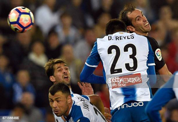 Atletico Madrid's Uruguayan defender Diego Godin vies with Espanyol's defender Diego Antonio Reyes during the Spanish league football match RCD...