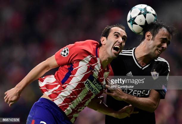 Atletico Madrid's Uruguayan defender Diego Godin vies with Qarabag's Azerbaijani defender Elvin Yunuszada during the UEFA Champions League football...