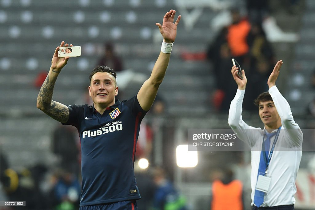 Atletico Madrid's Uruguayan defender Jose Maria Gimenez (L) and a teammate celebrate qualifying for the final after the UEFA Champions League semi-final, second-leg football match between FC Bayern Munich and Atletico Madrid in Munich, southern Germany, on May 3, 2016. / AFP / Christof Stache
