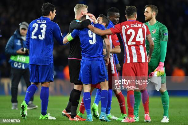 Atletico Madrid's Uruguayan defender Jose Maria Gimenez consoles Leicester City's English striker Jamie Vardy following the UEFA Champions League...