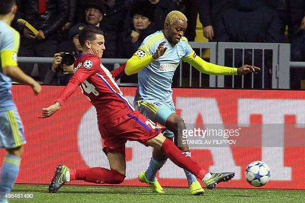 Atletico Madrid's Uruguayan defender Jose Maria Gimenez vies for the ball with Astana's Congolese forward Junior Kabananga during the UEFA Champions...