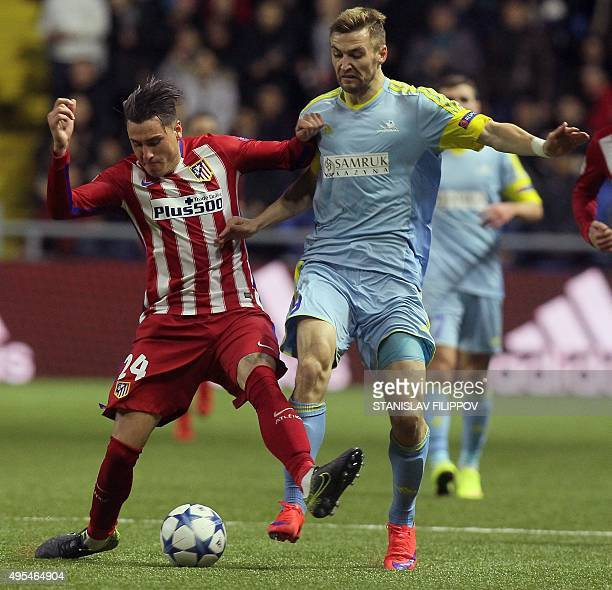 Atletico Madrid's Uruguayan defender Jose Maria Gimenez vies for the ball with Astana's Kazakh forward Aleksey Shchetkin during the UEFA Champions...