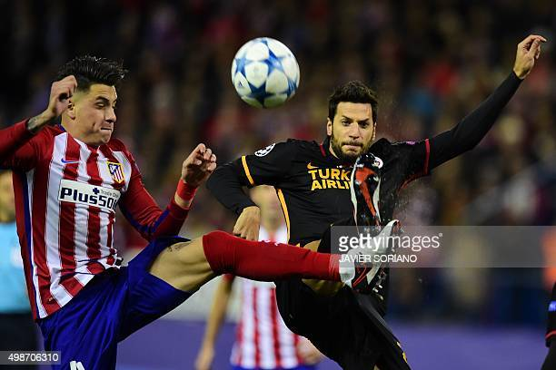 Atletico Madrid's Uruguayan defender Jose Maria Gimenez vies with Galatasaray's defender Hakan Balta during the UEFA Champions League Group C...