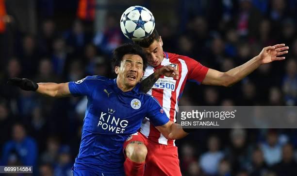 Atletico Madrid's Uruguayan defender Jose Maria Gimenez vies with Leicester City's Japanese striker Shinji Okazaki during the UEFA Champions League...