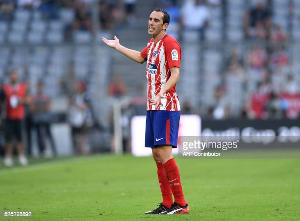 Atletico Madrid's Uruguayan Diego Godin gestures after he was shown the red card during the first Audi Cup football match between Atletico Madrid and...