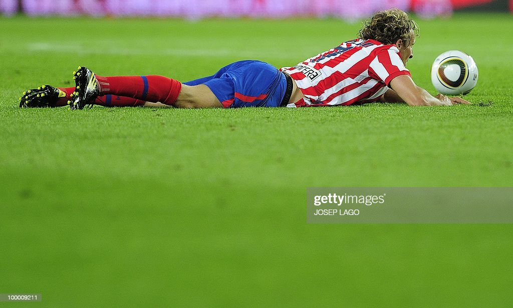 Atletico Madrid's Uruguayan forward Diego Forlan gestures during the King's Cup final match Sevilla against Atletico Madrid at the Camp Nou stadium in Barcelona on May 19, 2010.