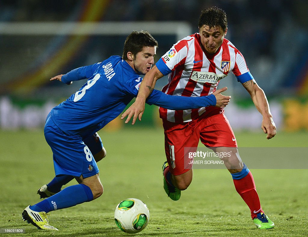 Atletico Madrid's Uruguayan midfielder Cristian Rodriguez (L) vies with Getafe's midfielder Pablo Sarabia (R) during the Spanish Copa del Rey (King's Cup) round of 16, second leg, football match Getafe vs Atletico de Madrid at the Coliseum Alfonso Perez stadium in Getafe on January 10, 2013.