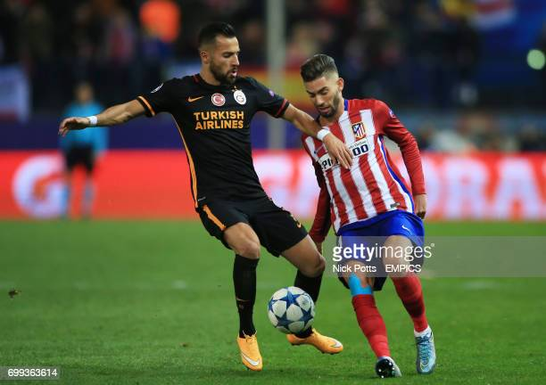 Atletico Madrid's Yannick FerreiraCarrasco and Galatasaray's Yasin Oztekin battle for the ball