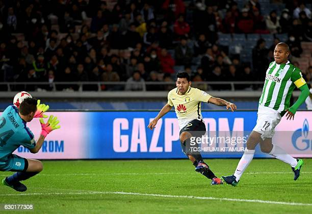 Atletico Nacional goalkeeper Franco Armani saves a shot on goal by Club America forward Silvio Romero during the Club World Cup thirdplace playoff...