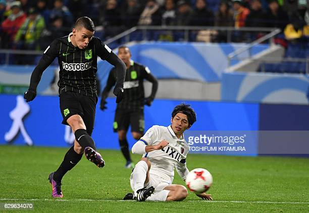 Atletico Nacional midfielder Mateus Uribe shoots the ball during the Club World Cup football semifinal match between Japan's Kashima Antlers and...