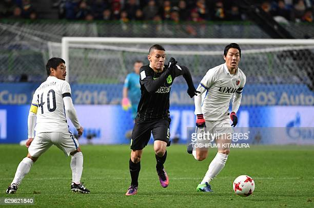 Atletico Nacional midfielder Mateus Uribe vies for the ball during the Club World Cup football semifinal match between Japan's Kashima Antlers and...