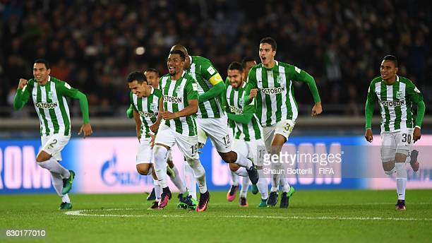 Atletico Nacional team celebrate victory on the half way line during the penalty shoot out during the FIFA Club World Cup 3rd Place match between...