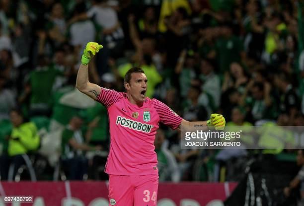 Atletico Nacional's goalkeeper Franco Armani celebrates after the team scored against Deportivo Cali during the Colombian Apertura football league...