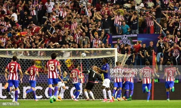 Atletico players celebrate their opening goal during the UEFA Champions League quarter final first leg football match Club Atletico de Madrid vs...