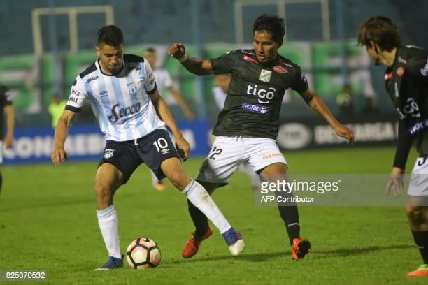 Atletico Tucuman's Gervasio Nunez vies for the ball with Oriente Petrolero's Helmut Gutierrez during their Copa Sudamericana 2017 football match at...