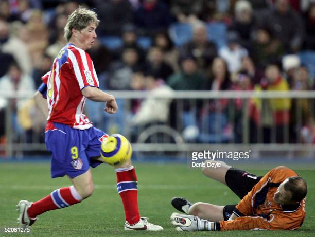 Atleticos Fernando Torres dribbles the ball past Albacetes goalkeeper Roland Gaspercic during an Atletico Madrid v Albacete Primera Liga match at the...