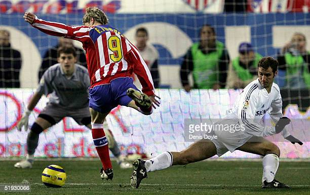 Atleticos Fernando Torres gets past Reals Ivan Helguera in an Atletico Madrid v Real Madrid La Liga soccer derby at the Calderon on January 9 2005 in...