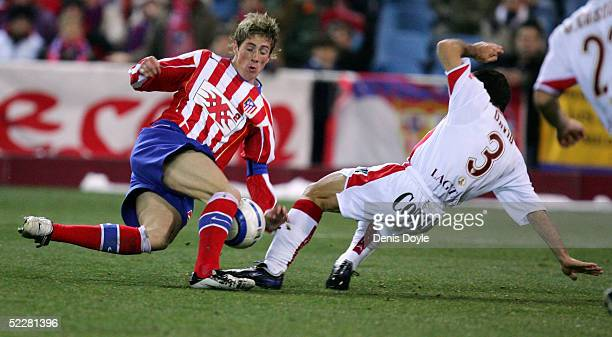 Atletico's Fernando Torres is tackled by David Castedo of Sevilla during a Primera Liga soccer match on March 5 2005 between Atletico Madrid and...