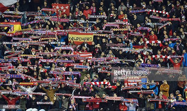 Atletico's supporters hold their team's scarves during the UEFA Champions League Group C football match Club Atletico de Madrid vs Galatasaray AS at...